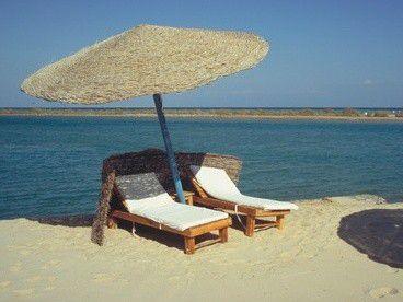 Sonne, Sand und Meer: Wer sich optimal erholen will, sollte sein Laptop zu Hause lassen.