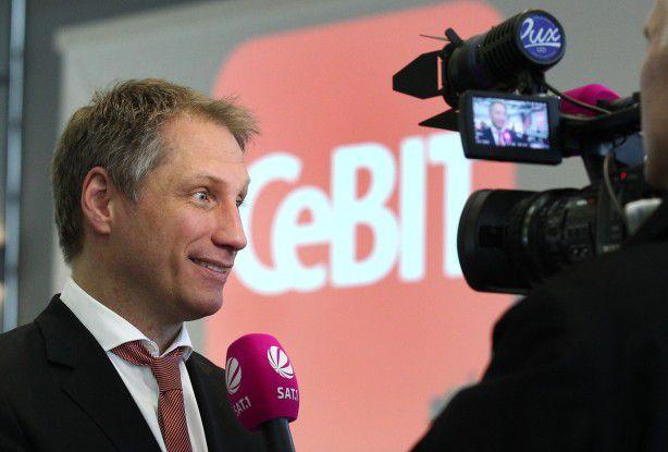 Messemacher Frank Pörschmann steht zum CeBIT-Motto Shareconomy.