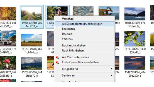 """Zwei Fotos markieren und dann im Kontextmenü """"Als Desktophintergrund festlegen"""" auswählen. Das erste Foto landet als Wallpaper auf dem Monitor 1 und das zweite auf Monitor 2."""