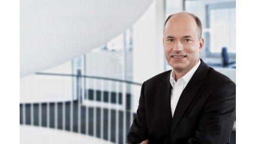 Secusmart-CEO Hans-Christoph Quelle freut sich über die neuen sicheren Handys für die Regierung.
