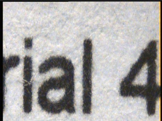 Text unter der Lupe: Der Oki C3450n zeigte im Test ein durchaus sauberes Schriftbild