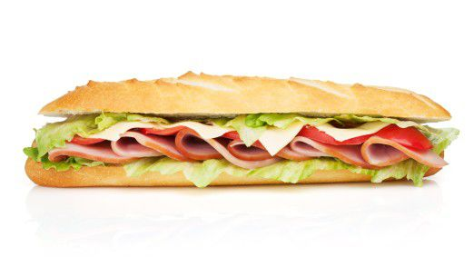 Druck von beiden Seiten: Viele Mittelmanager fühlen sich wie das Salatblatt in einem Sandwich.