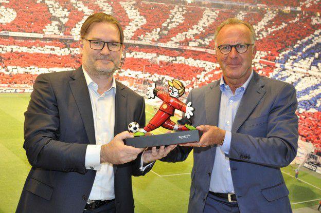 Gigaset-Chef Charles Fränkl der Vorstandvorsitzende von Bayern München, Karl-Heinz Rummenige.