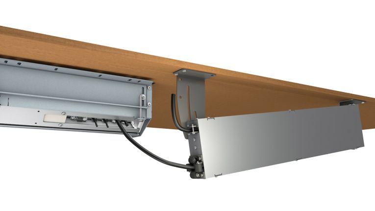 Kindermann Cable Caddy: hier mit Gehäuse unterm Tisch.