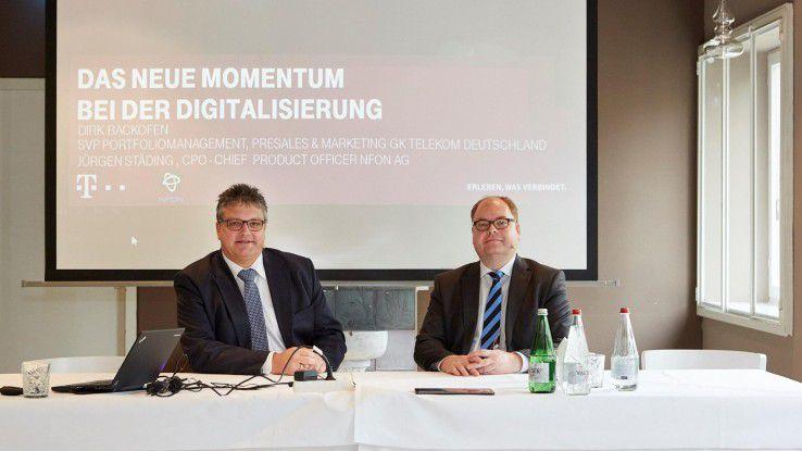 Dirk Backofen, Leiter Marketing Geschäftskunden der Telekom Deutschland GmbH, und Jürgen Städing, CPO bei NFON, verkünden ihre Partnerschaft.