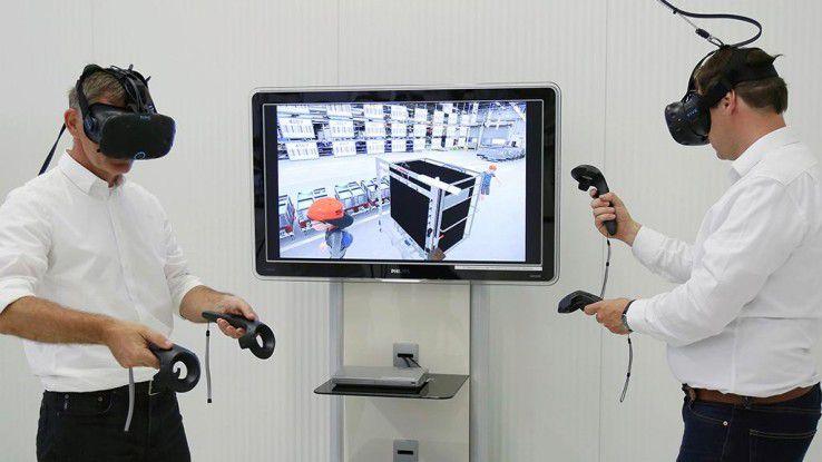 Volkswagen-Mitarbeiter nutzen die VR-Technik, um sich mit Kollegen in einer Logistikhalle in Tschechien zu Verbesserungen beim Kommissionieren auszutauschen.