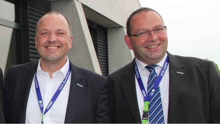 Die Bluechip-Vorstände Sven Buchheim und Hubert Wolf sind zufrieden mit der Umsatz- und Gewinnentwicklung ihres Unternehmens.