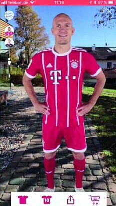 Mithilfe der AR-Funktion der FCB-München-App können Sie sich die Bayern-Stars ins Wohnzimmer holen.