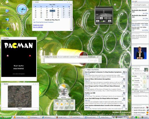 """Ein PC-Desktop, bevölkert von Google Desktops """"Gadgets"""" und dem Schnellsuchfeld in der Mitte."""